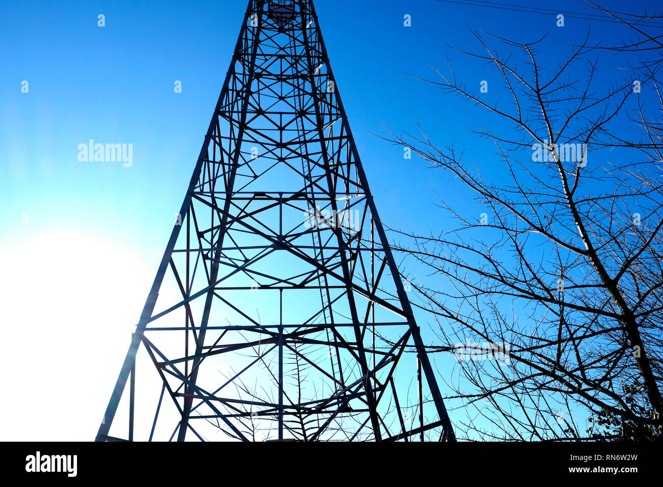 Electricity Pylon on the banks of the Medina River, Newport, isle of Wight, England, UK - Stock Image