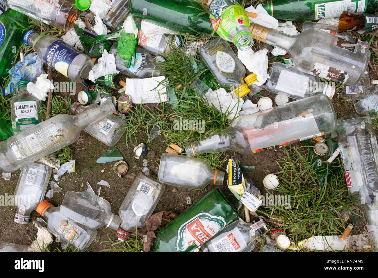 Garbage, mess, rubbish, bottles on the ground. Alcoholism in the little city. Gniezno, Poland - Stock Image