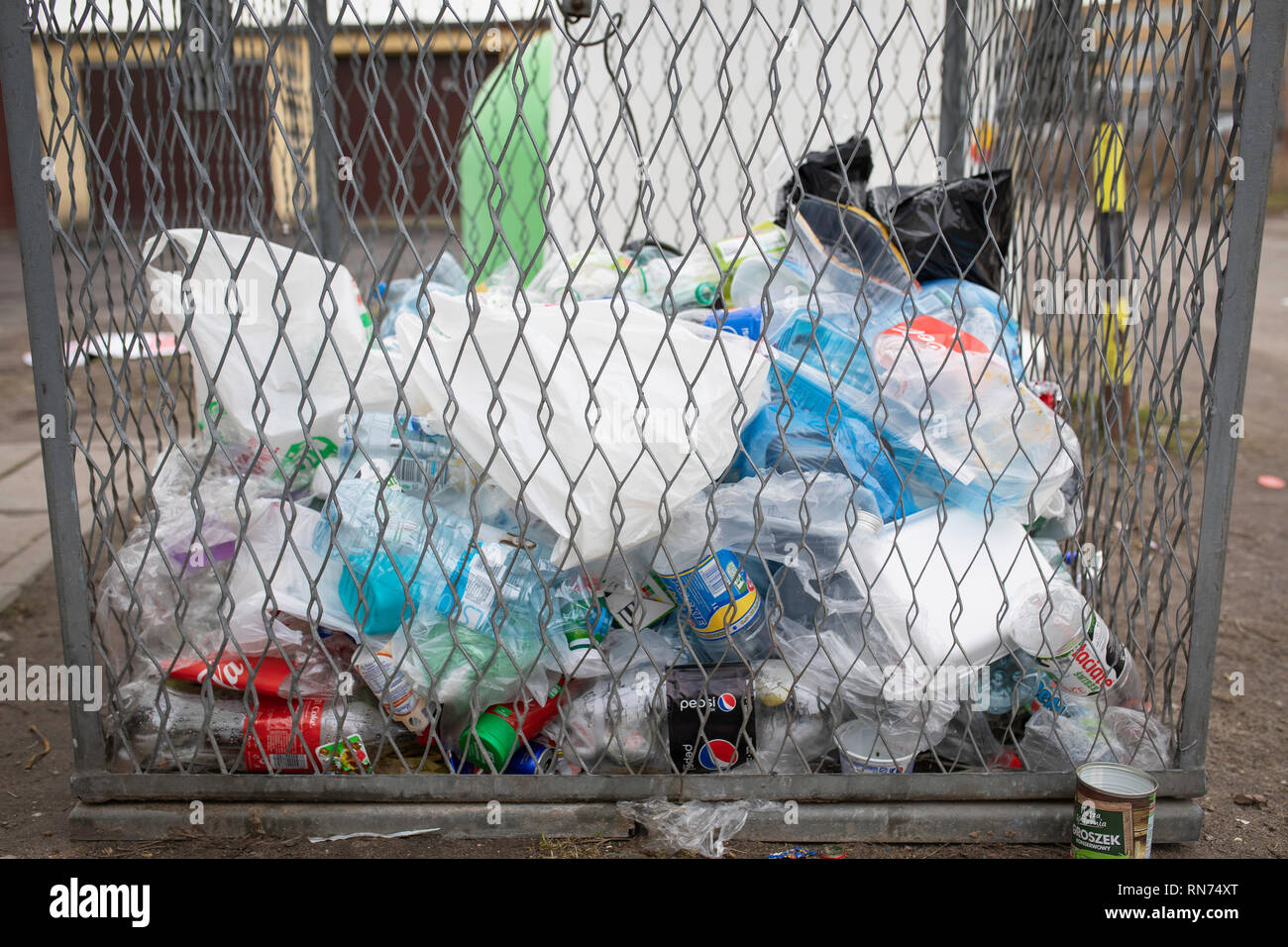 Plastic waste container. Garbage, mess, rubbish, bottles on the ground. Gniezno / Poland - Stock Image