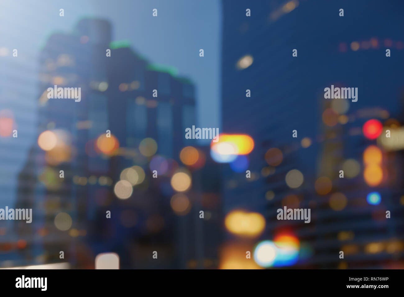 Night city lights bokeh background,lights blurred building bokeh background for design colorful of city night Stock Photo
