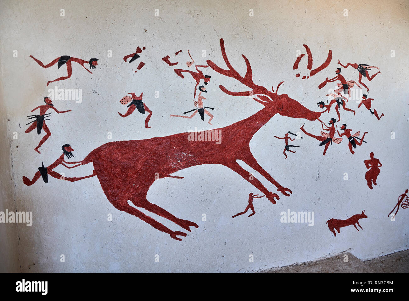 Recontructed fresco of an original found at Catalhoyuk. The men are hunting a deer and pulling on its tounge to disable it. The hunters are believed b - Stock Image