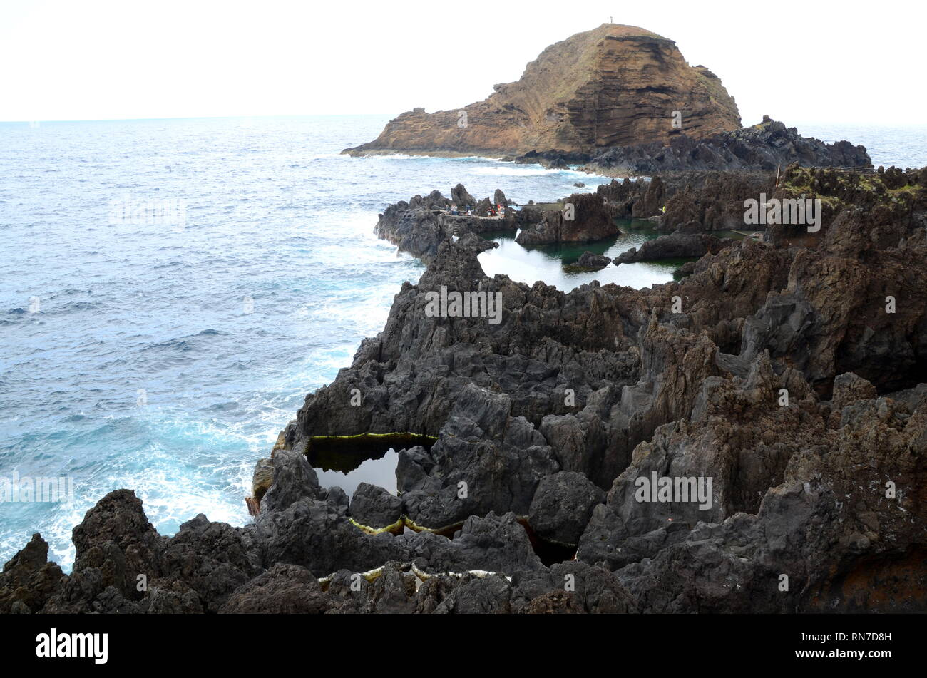 Natural swimming pools formed by volcanic rocks at Porto Moniz, Madeira - Stock Image