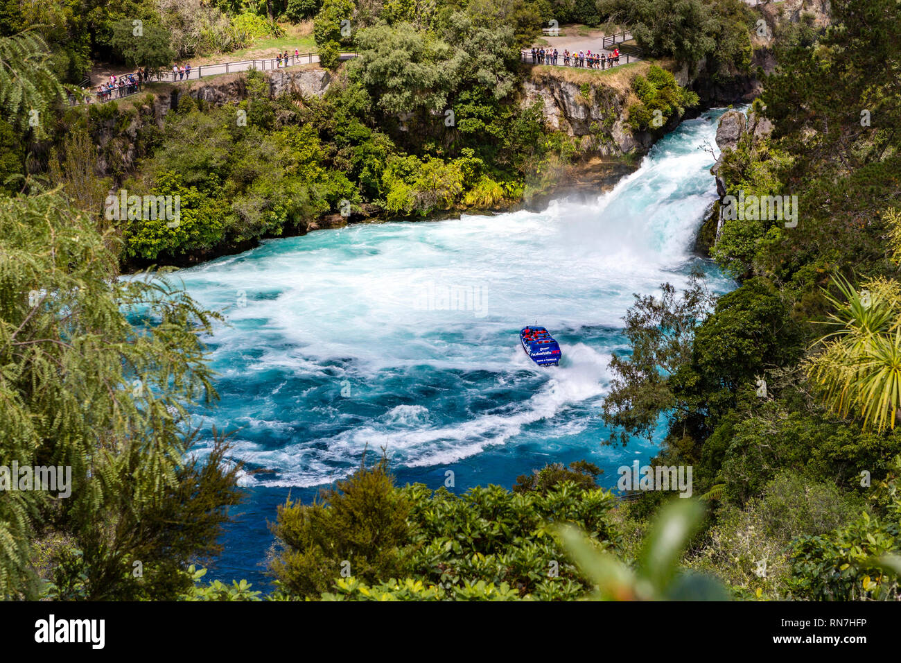 Taupo, New Zealand - April 26 2017: Tourist adventure in Huka Falls with Huka jet boat the most famous iconic thriller activity in Taupo, New Zealand. - Stock Image