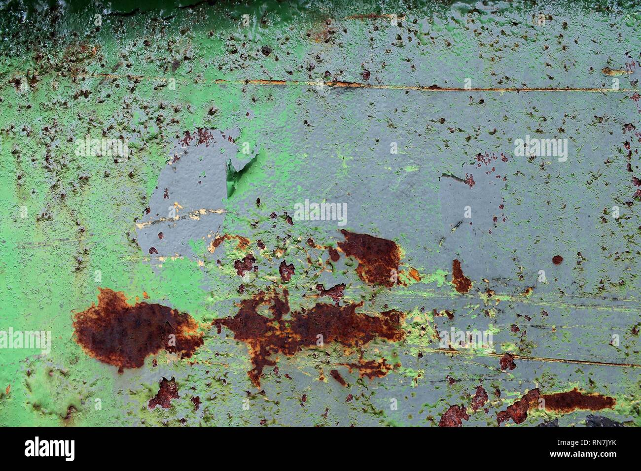 Close up surface of aged and weathered rusty metal surfaces in high resolution - Stock Image