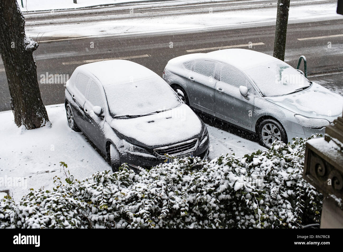 Strasbourg, Alsace, France, snowy parked cars on pavement, - Stock Image