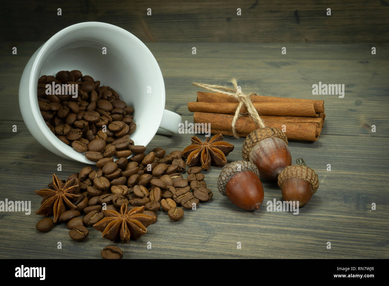 Roasted Coffee Beans Spilling From A Cup Acorns And