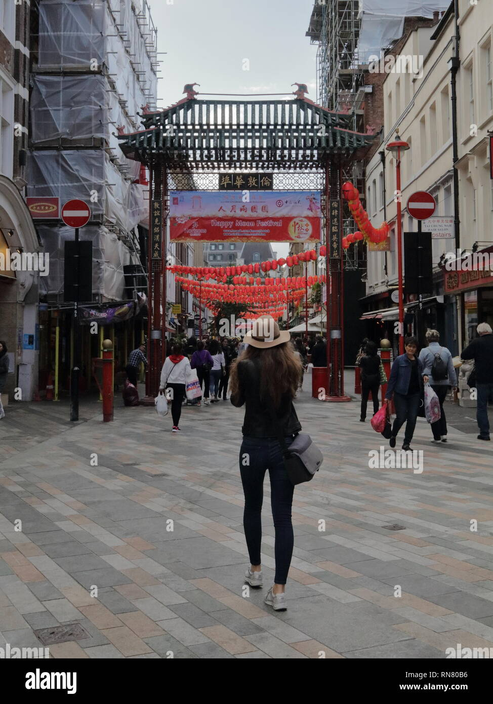 Girl taking a picture in Chinatown London central. Stock Photo
