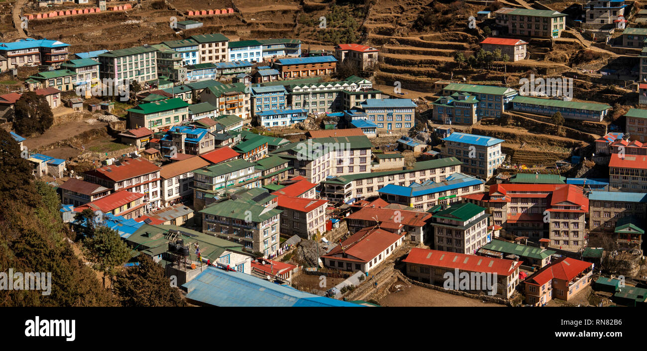Nepal, Namche Bazaar, elevated panoramic view down onto town rooftops from Gompa - Stock Image