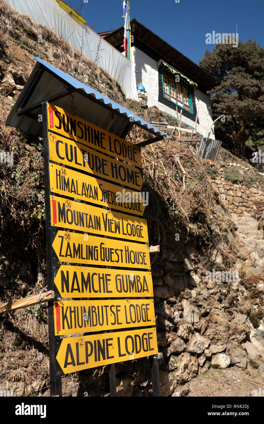 Nepal, Namche Bazaar, tourism, signs to Hotels, Guest Houses and Lodges - Stock Image