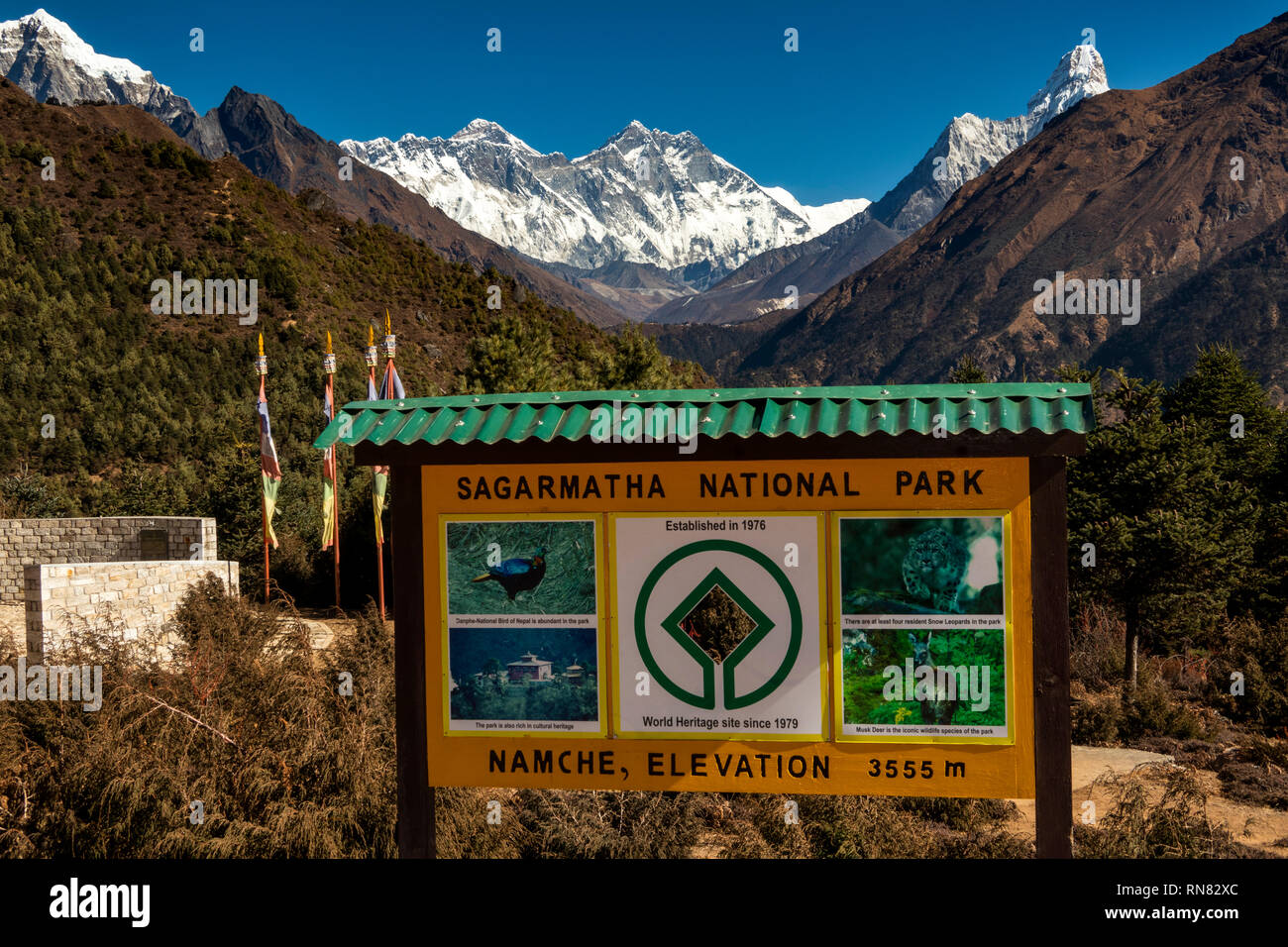 Nepal, Namche Bazaar, Sagarmatha National Park, Visitor Centre, sign at 3555 metres elevation, in front of view of Mount Everest - Stock Image