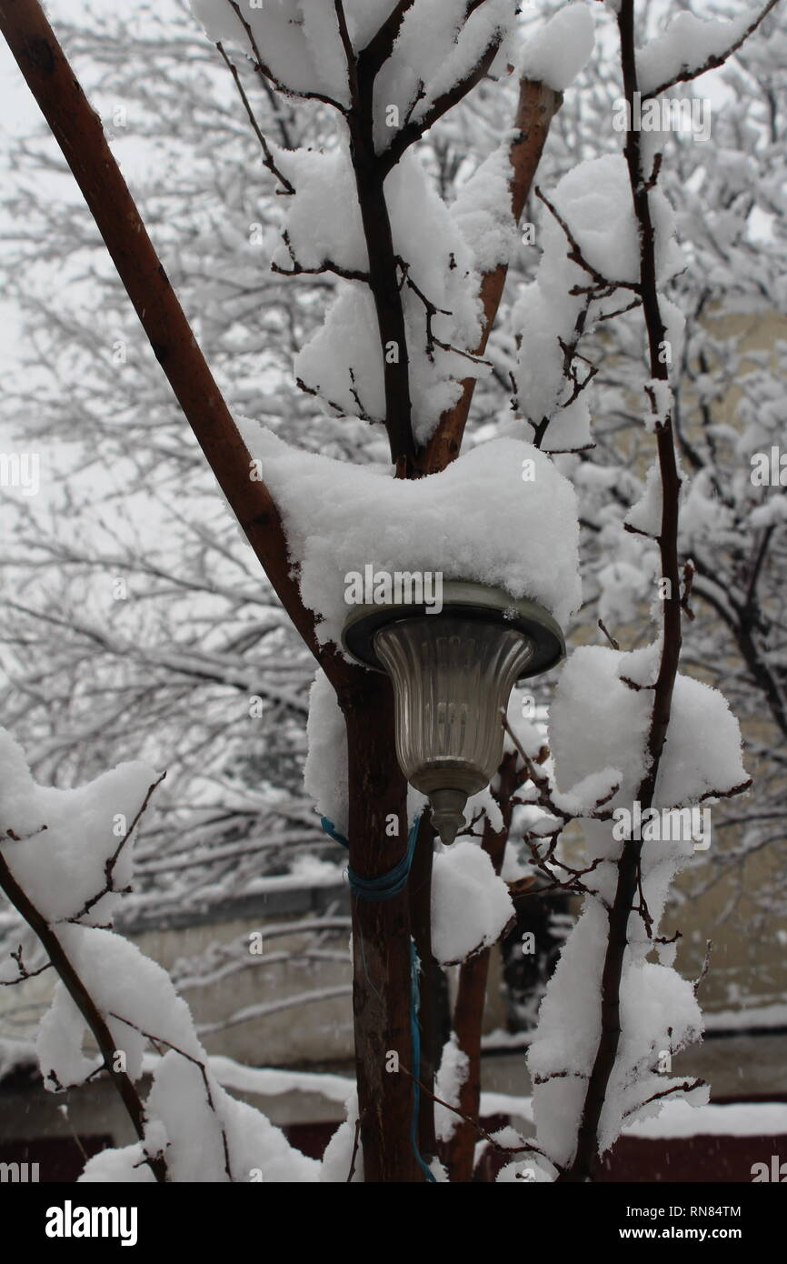 A vertical picture of a pendant light in a snowy morning in Kabul, Afghanistan. - Stock Image