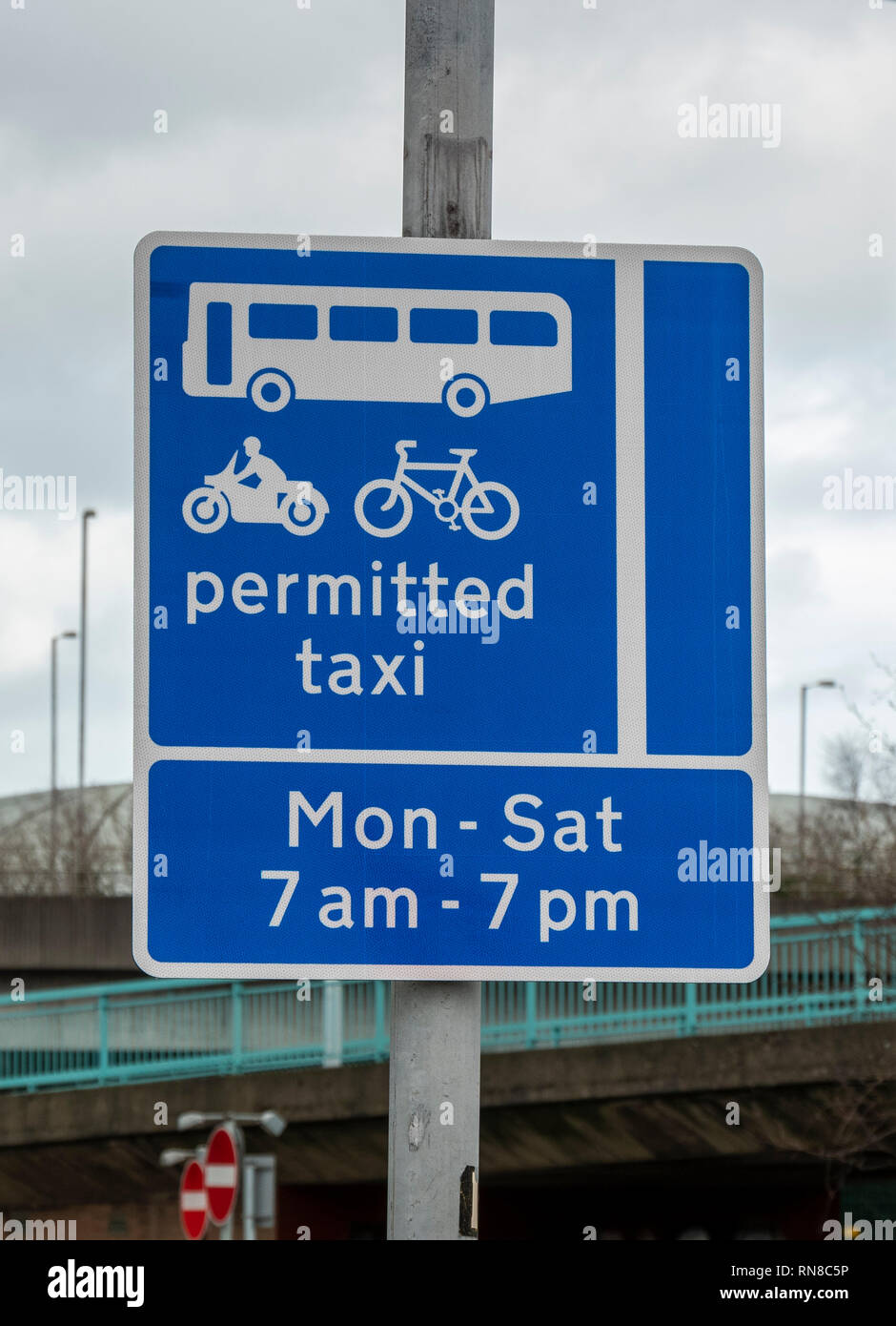 Taxi permitted sign with timings, Belfast, - Stock Image