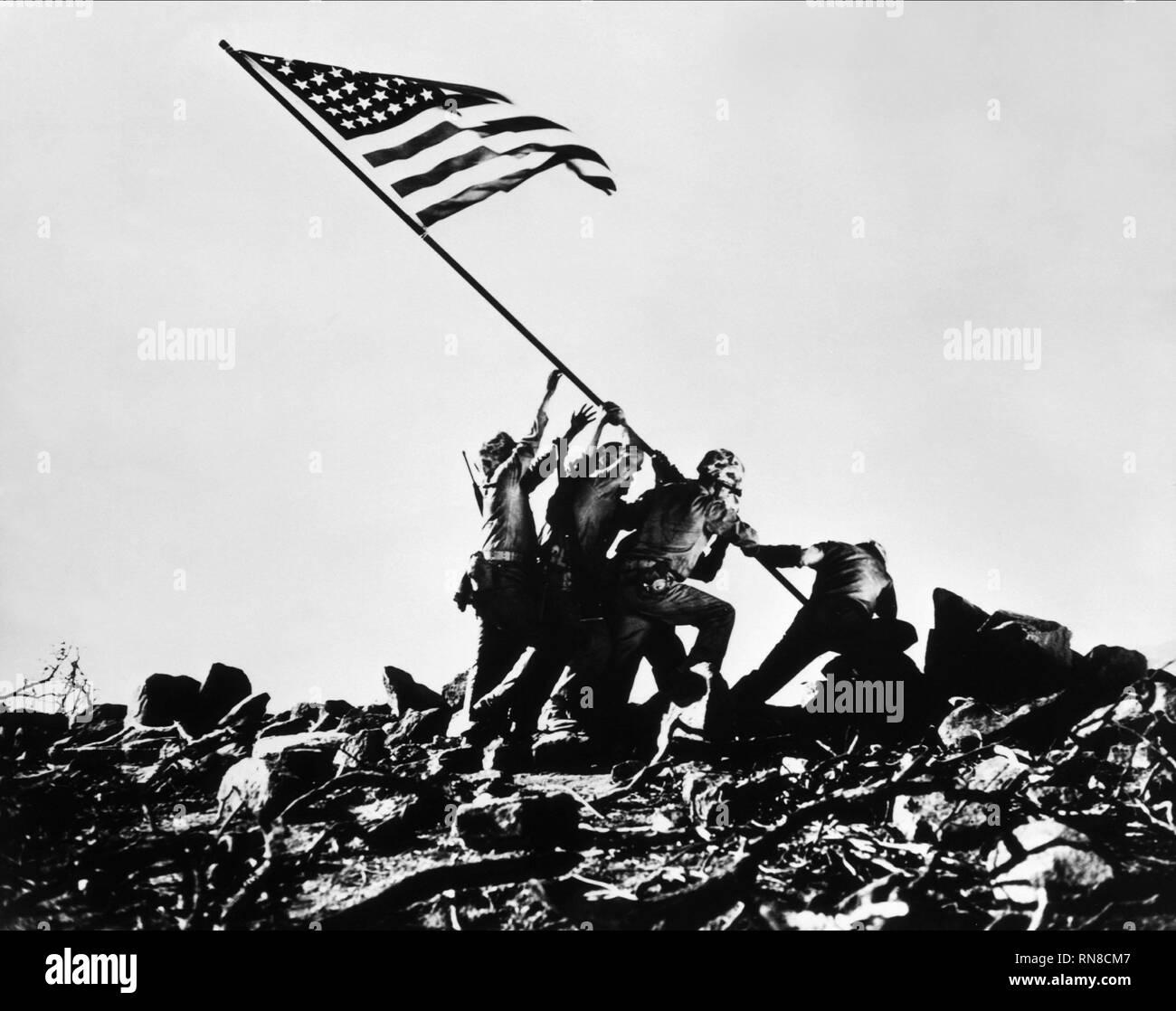 SCENE WITH TROOPS RAISING FLAG, SANDS OF IWO JIMA, 1949 - Stock Image