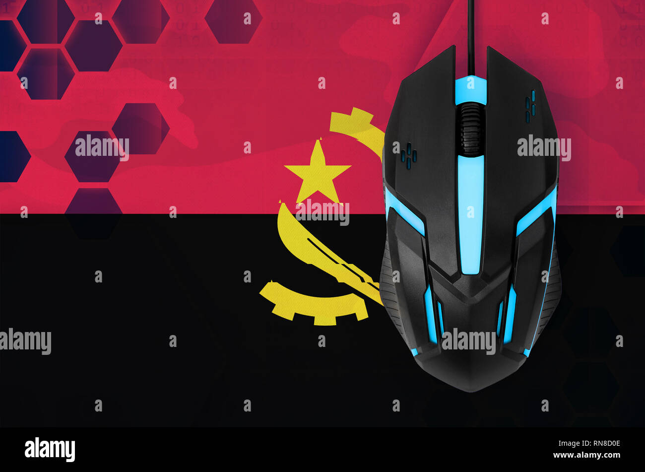 Angola flag  and modern backlit computer mouse. Concept of country representing e-sports team - Stock Image