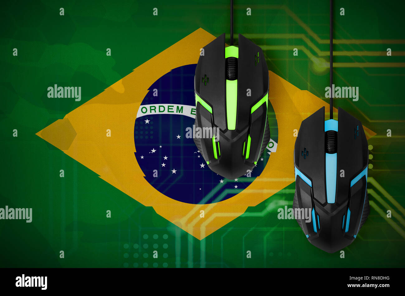 Brazil flag  and two modern computer mice with backlight. The concept of online cooperative games. Cyber sport team - Stock Image