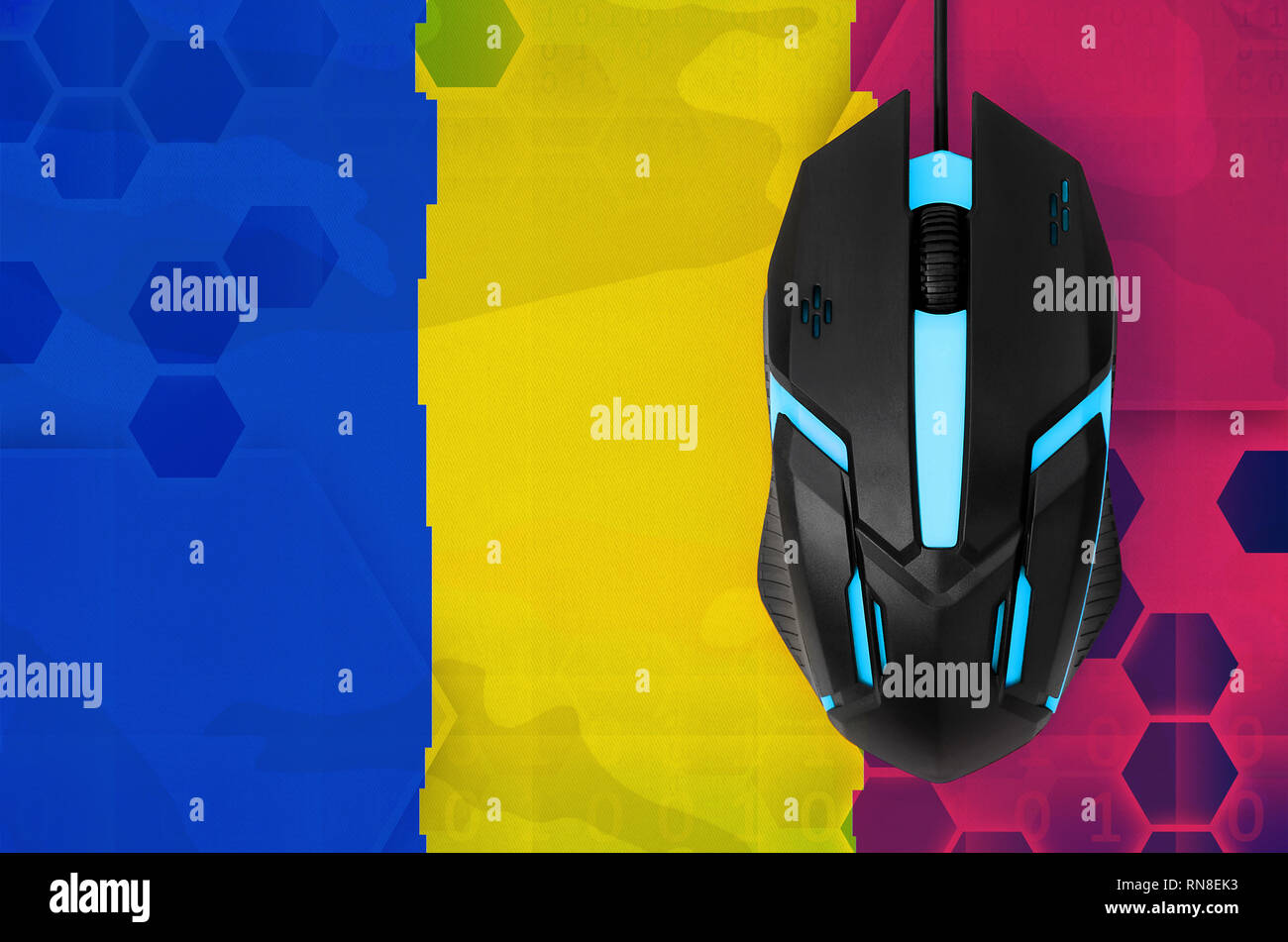 Chad flag  and modern backlit computer mouse. Concept of country representing e-sports team - Stock Image
