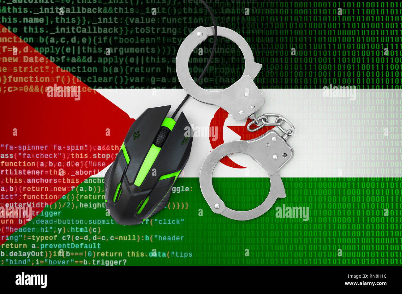 Western Sahara flag  and handcuffed modern backlit computer mouse. Creative concept of combating computer crime, hackers and piracy - Stock Image