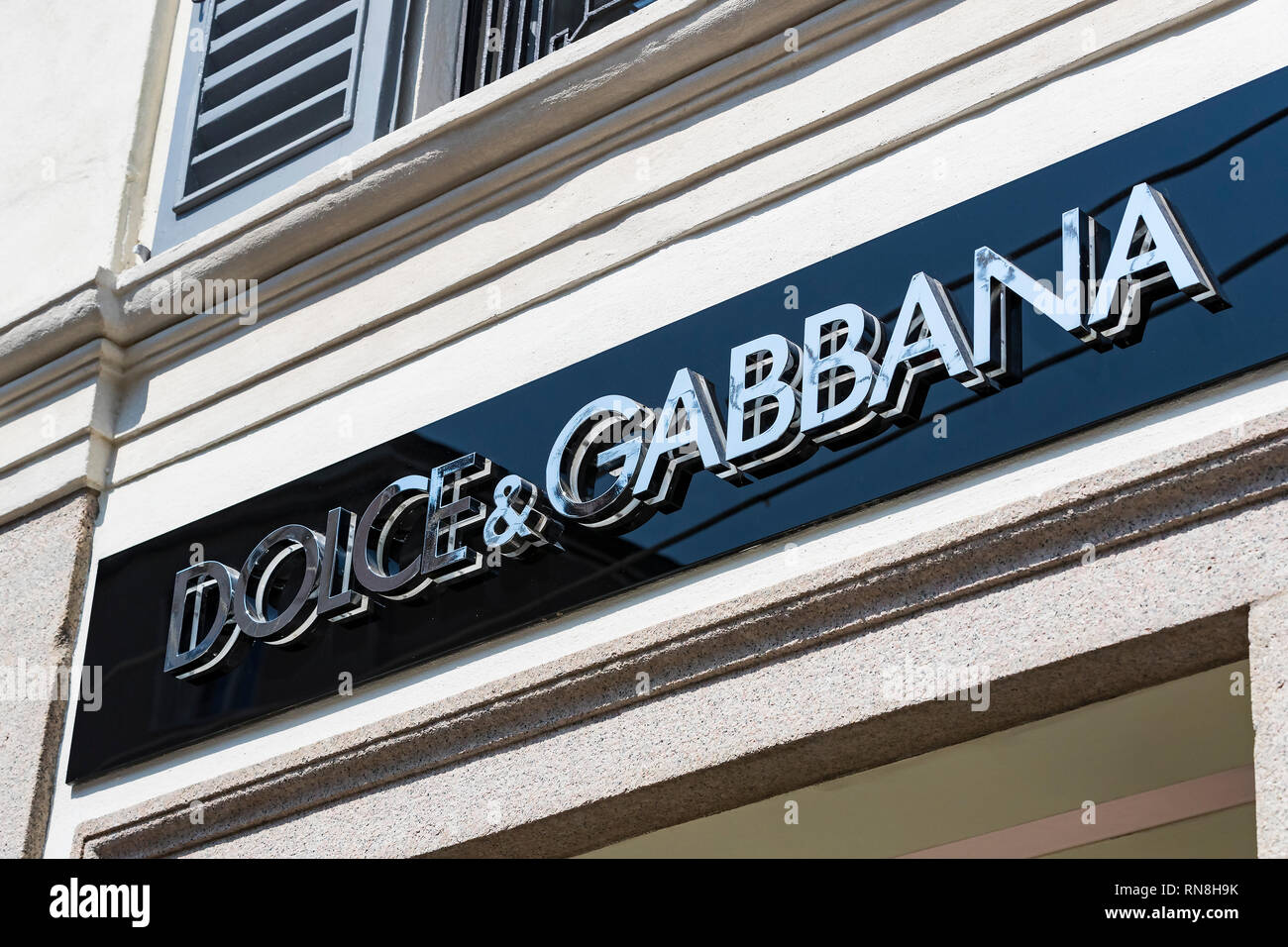 MILAN, ITALY - 2 JUNE, 2018: Logo of the Dolce & Gabbana store on the street of Milan in Italy. - Stock Image