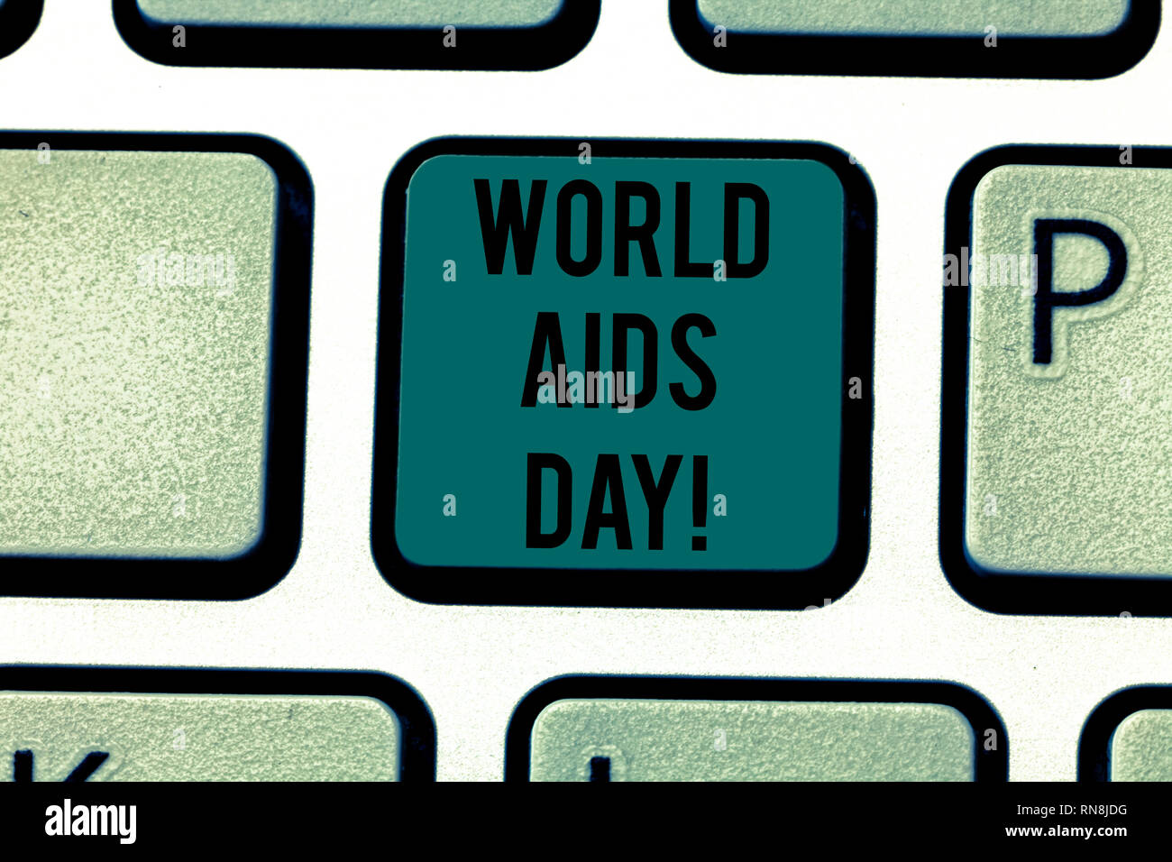 Conceptual hand writing showing World Aids Day. Business photo text 1st December dedicated to raising awareness of the AIDS Keyboard key Intention to  - Stock Image