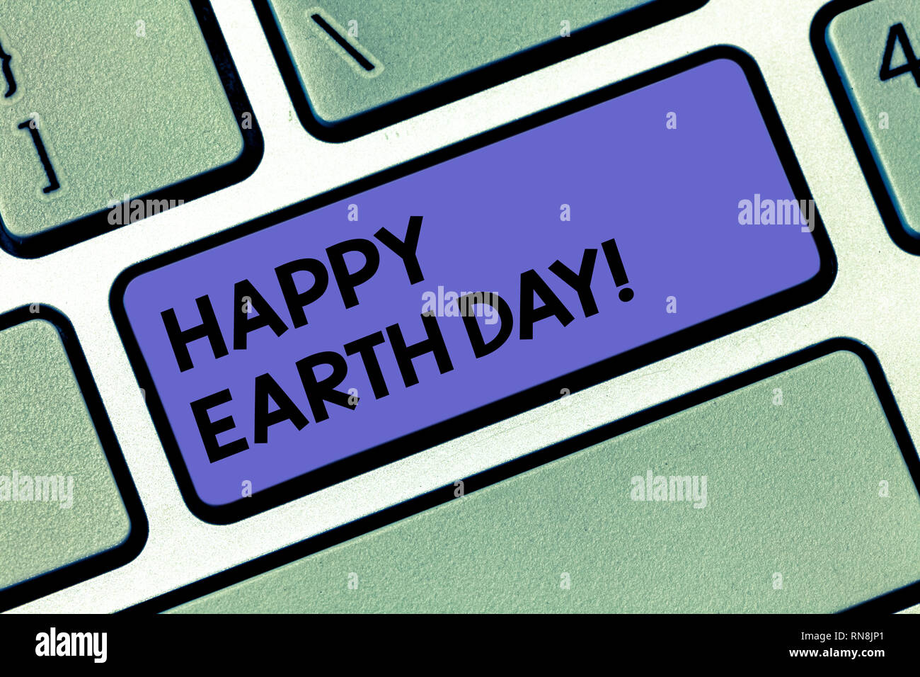 Handwriting text Happy Earth Day. Concept meaning Worldwide celebration of ecology environment preservation Keyboard key Intention to create computer  Stock Photo