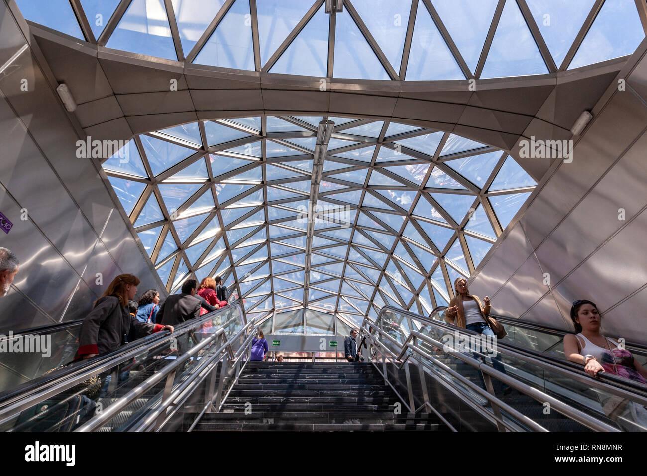Travellers down via escalators in the modern Metro Sol entrance, Puerta del Sol, Madrid, Spain Stock Photo