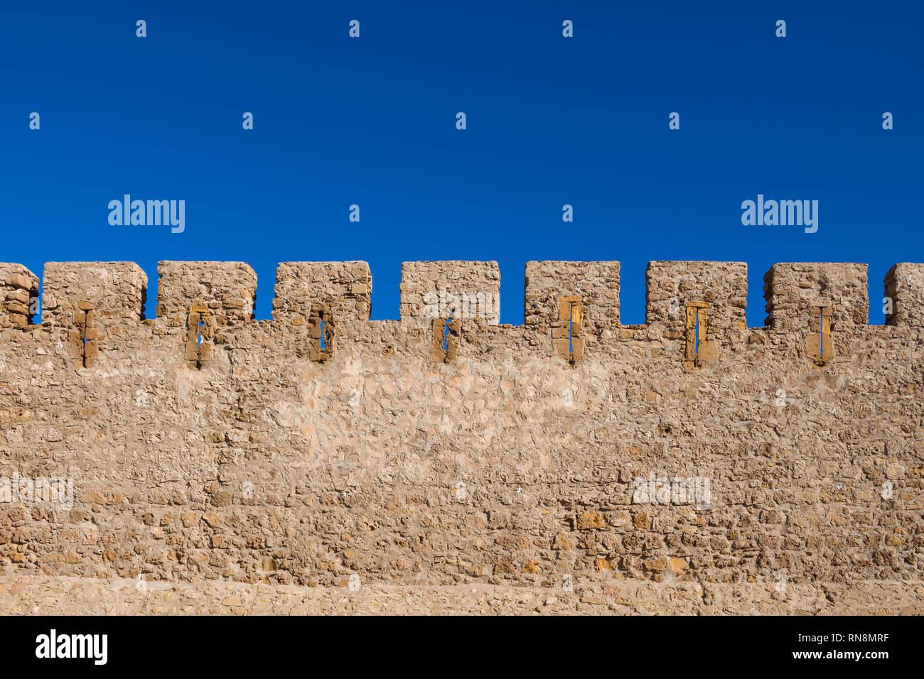 78cd71d3f80a Detai of the stone wall of the former historical portuguese fortress  (castle) Dar el