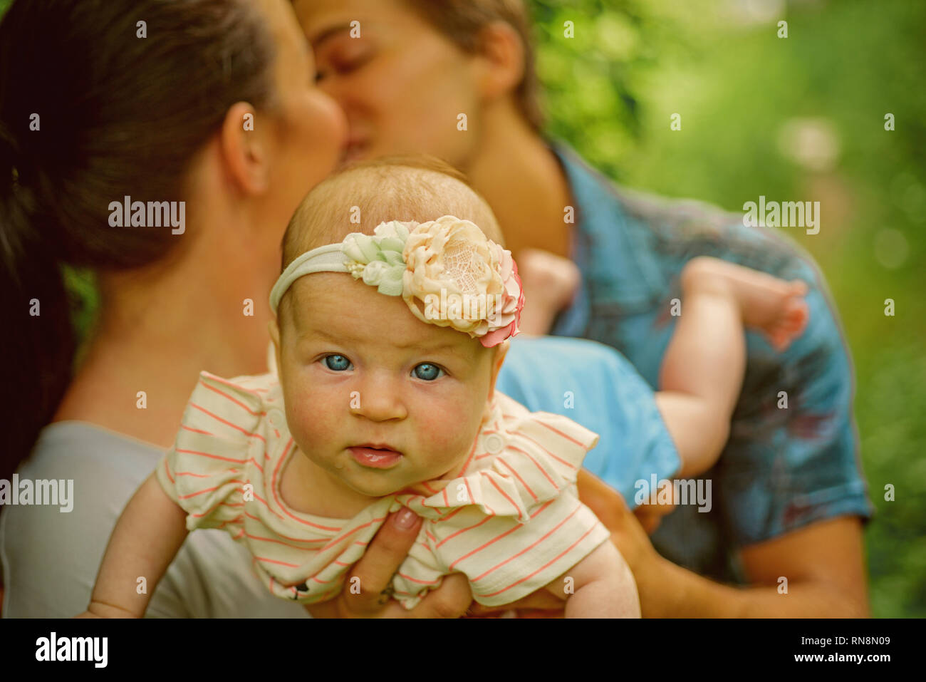 Mutual understanding between parents in family. Family love of newborn. Parents love their newborn child. Developing mutual understanding - Stock Image