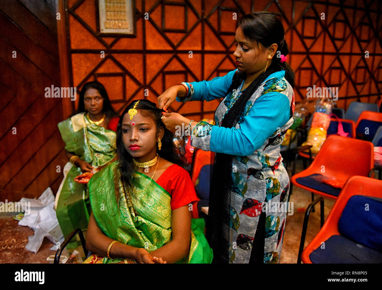 Girls are seen getting ready and  as they wait for the marriage ceremony during the Mass Marriage programme at Kolkata. Mass marriage programme was organised on the eve of the Valentine week of 164 Couples in the city of Kolkata by a NGO named Aloy Fera. Stock Photo