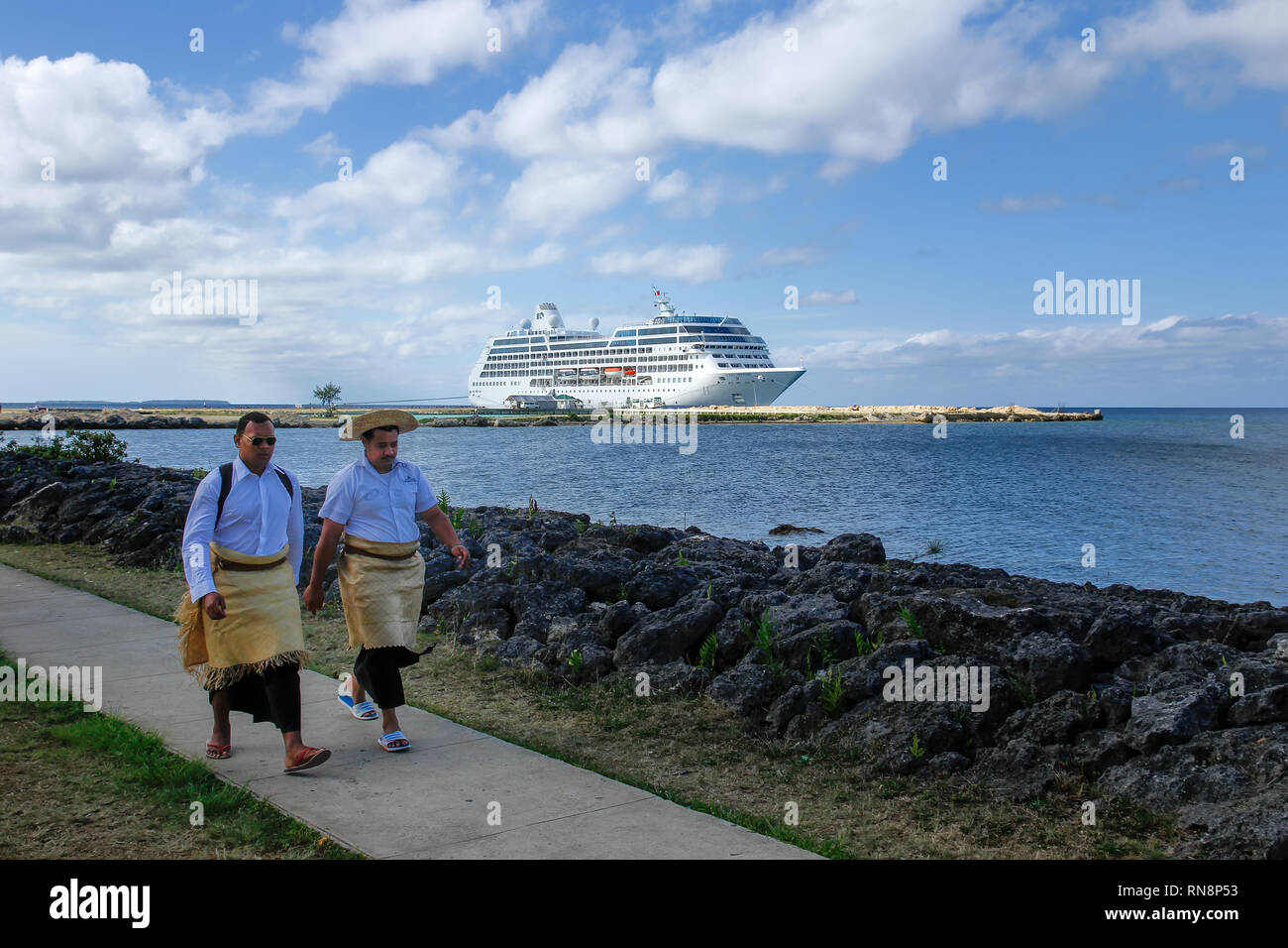 Local men walking at the waterfront in Nuku'alofa on Tongatapu island, Tonga. Nukuʻalofa is the capital of the Kingdom of Tonga Stock Photo