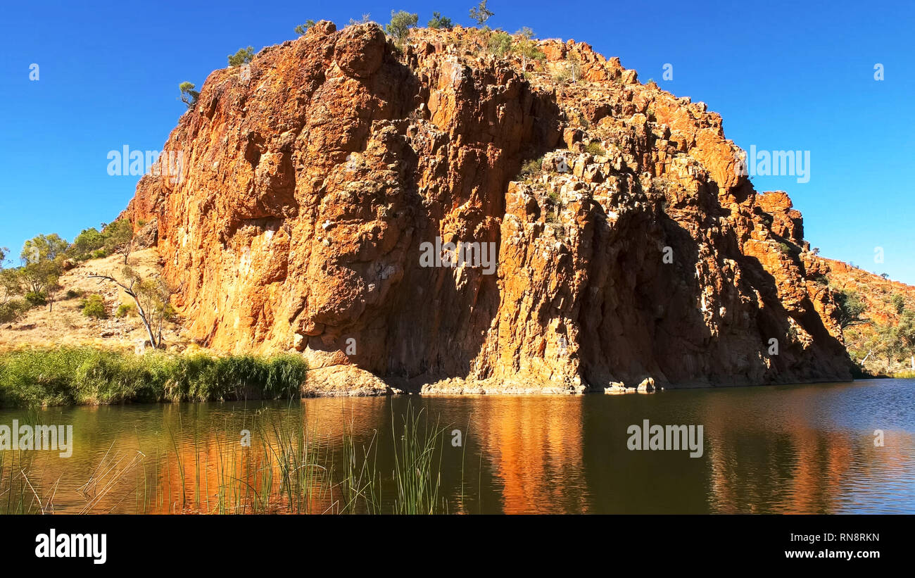 the large rocky outcrop at glen helen gorge in the west macdonnell ranges near alice springs - Stock Image