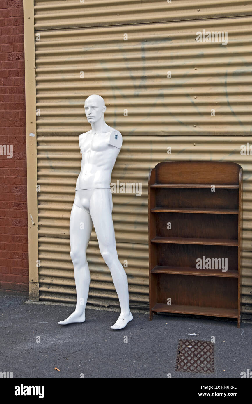 An armless shop dummy stands outside a secondhand shop in the Stokes Croft area of Bristol, UK. - Stock Image