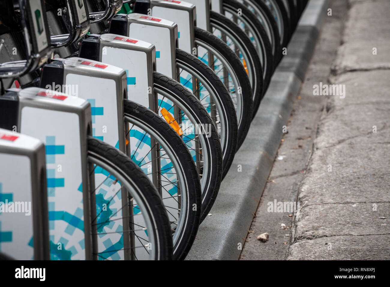 MONTREAL, CANADA - NOVEMBER 7, 2018: Row of bicycle wheels belonging to the bike renatl service Bixi Montreal, on one of their rental station, special - Stock Image
