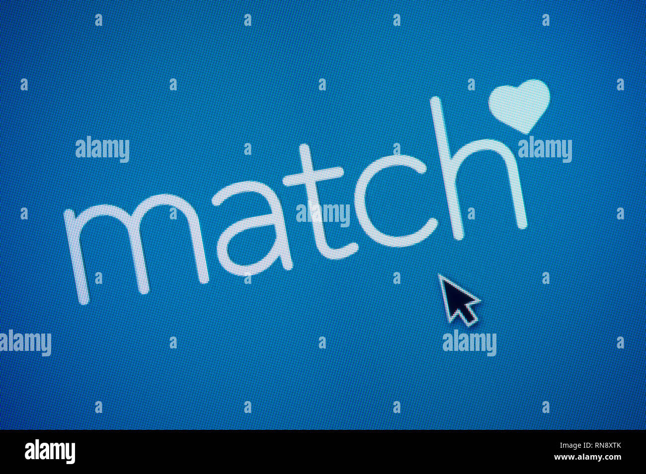 The logo of Match.com is seen on a computer screen along with a mouse cursor (Editorial use only) - Stock Image