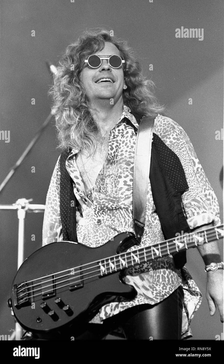 Damn Yankees bassist Jack Blades is shown performing on stage during a 'live' concert appearance. - Stock Image