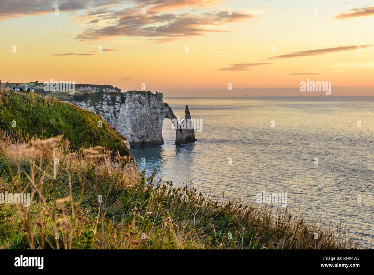 Beautiful view of cliffs Aval of Etretat and beautiful famous coastline ,Normandy, France, Europe at sunset - Stock Image