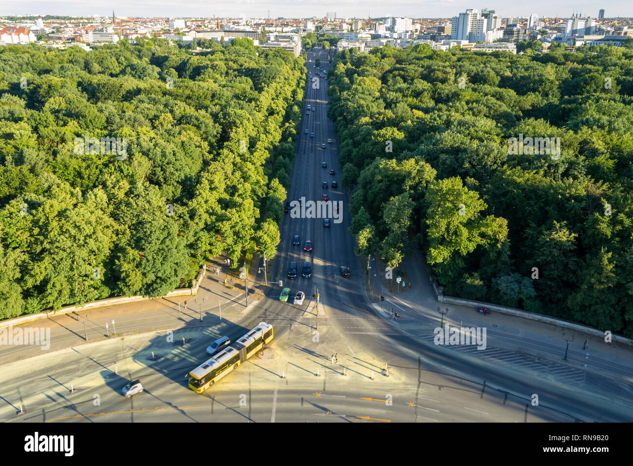 Aerial view of Berlin, Germany, as seen from the Victory Column  (Siegessäule) tower, in a Summer afternoon. Großer Tiergarten park, long street in th - Stock Image