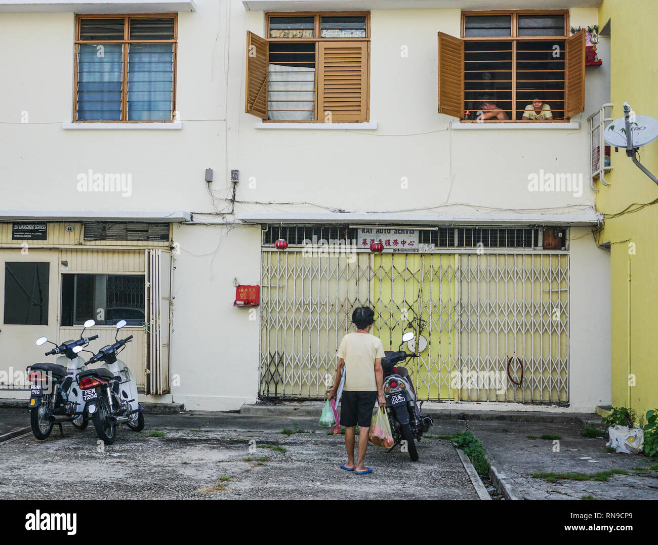 George Town, Malaysia - Aug 21, 2014. People on the old street in downtown. George Town is known for its British colonial buildings, Chinese shophouse - Stock Image
