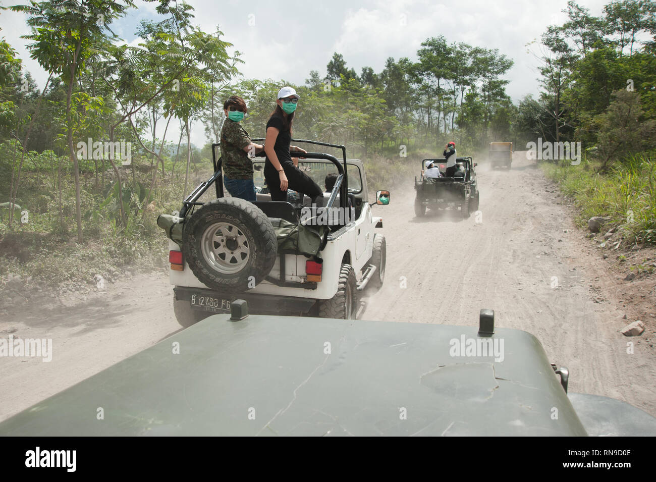 Yogyakarta  Indonesia - Aug 1, 2016 : A group of tourist on four while drive vehicle exploring Mount Merapi trails to witness volcano destruction. - Stock Image