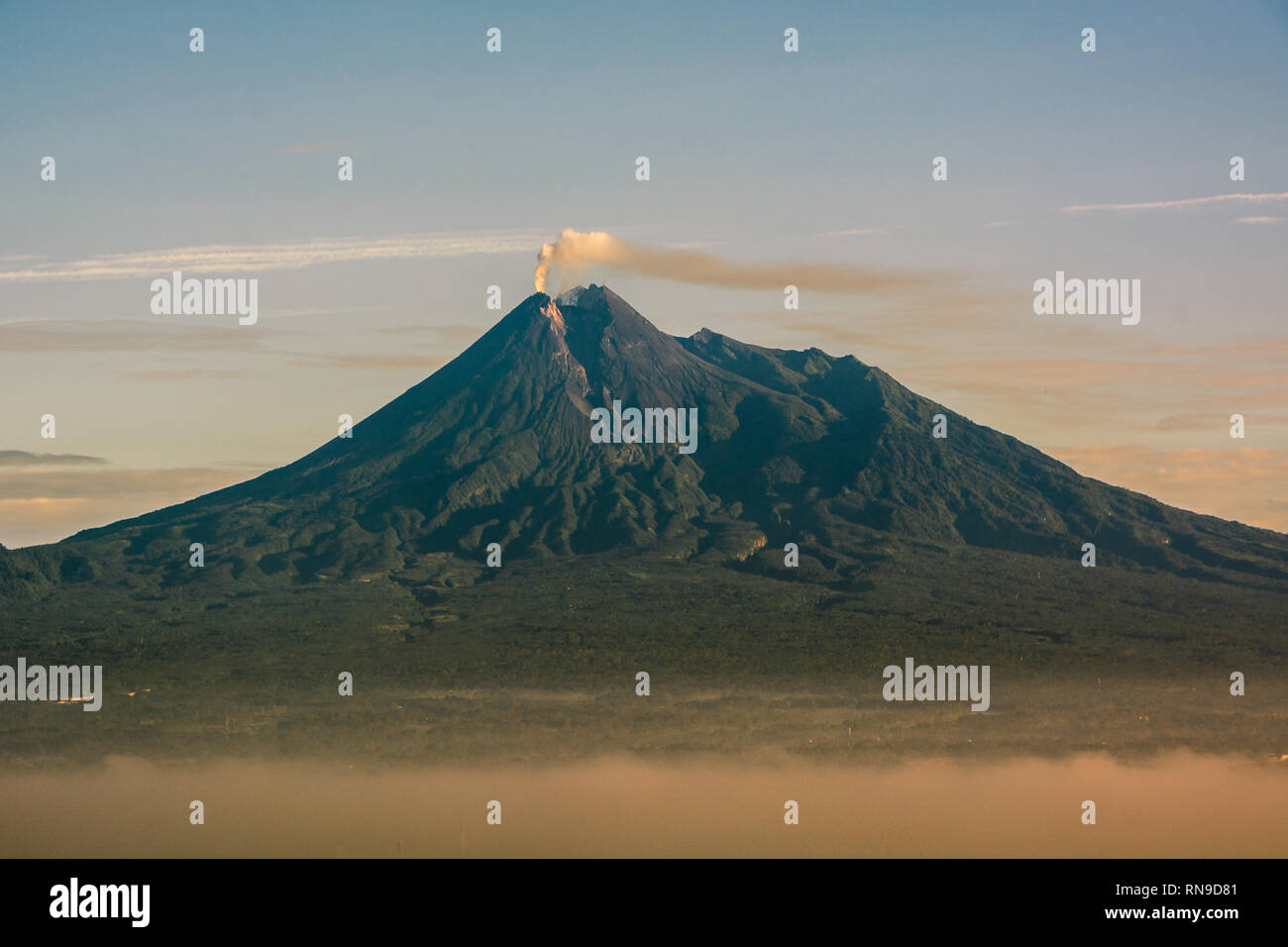 beauty of sunrise merapi mountain, indonesia. Mount Merapi is one of the most active mountains in Indonesia - Stock Image