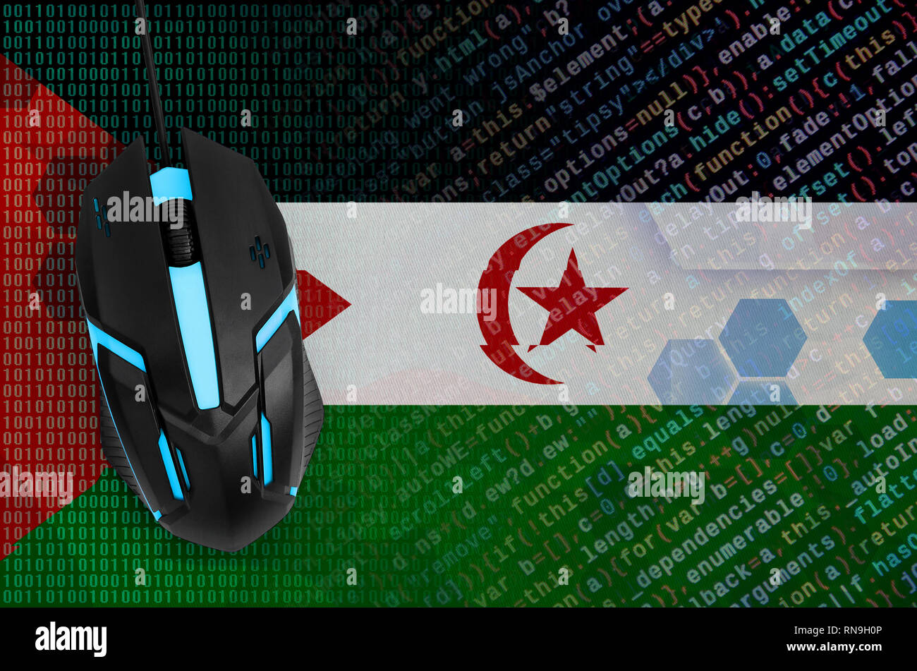 Western Sahara flag  and modern backlit computer mouse. The concept of digital threat, illegal actions on the Internet - Stock Image