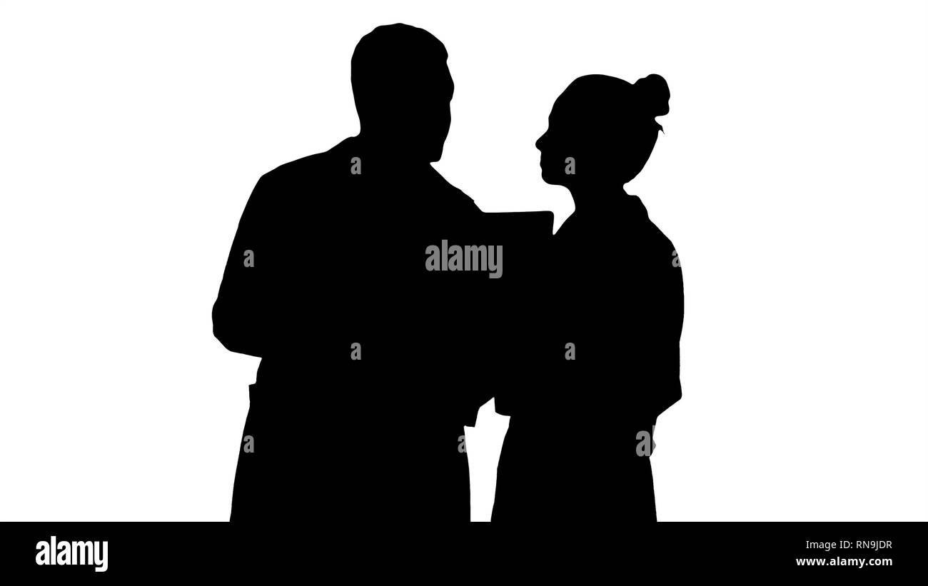 Silhouette Serious nice woman doctor and afro american doctor study brain x ray. Stock Photo