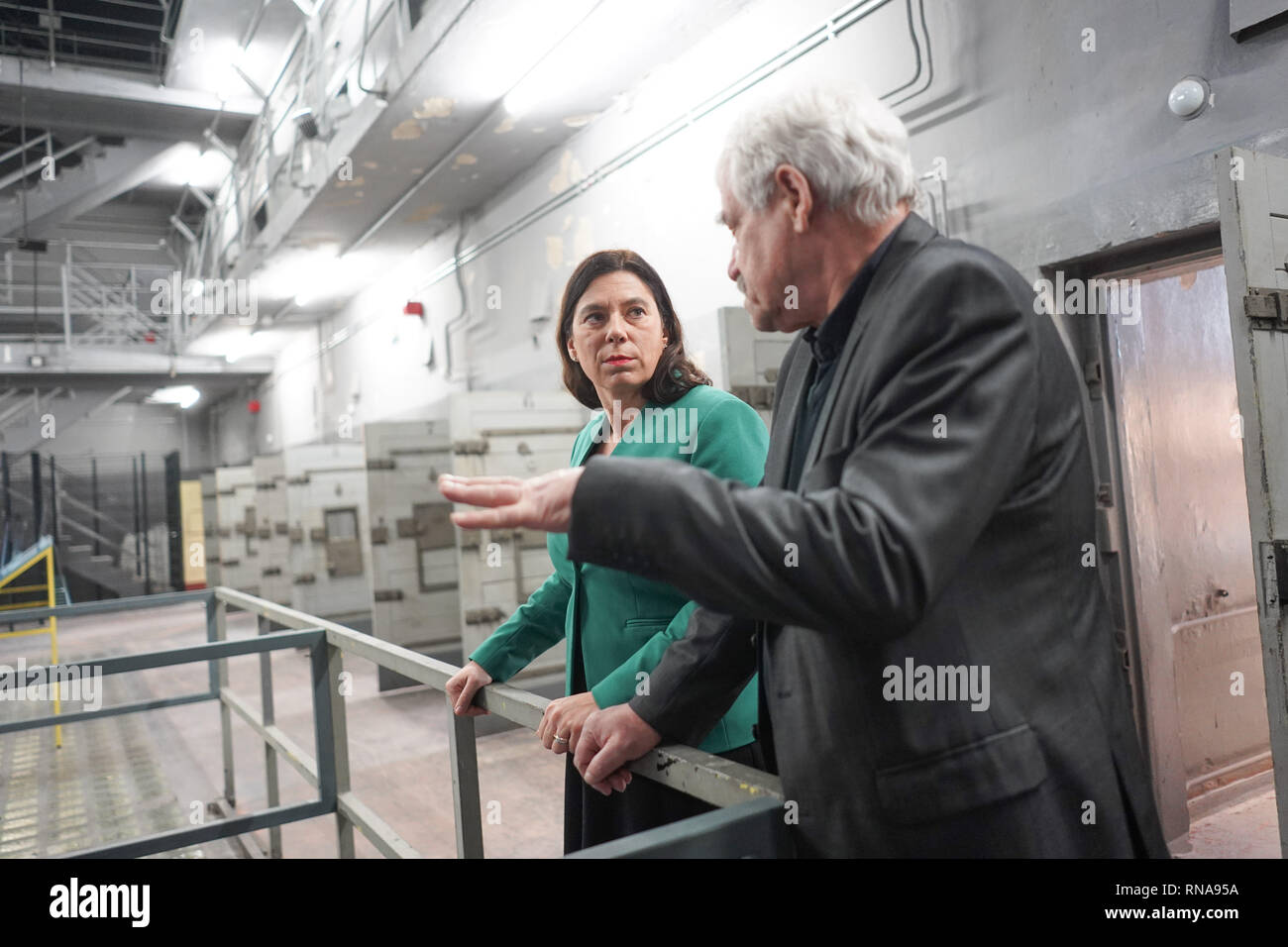 Berlin, Germany. 18th Feb, 2019. Sandra Scheeres (l, SPD), Berlin's senator for education, and the 70-year-old contemporary witness Michael Brack, open an extracurricular place of learning in the former East German police prison Keibelstraße. According to the Senator, young people there will be able to deal with state arbitrariness and repression in the GDR in the future. Guided tours of the building are also planned for interested visitors. The prison stood empty for years, the use had been struggled for a long time. Credit: Jörg Carstensen/dpa/Alamy Live News - Stock Image