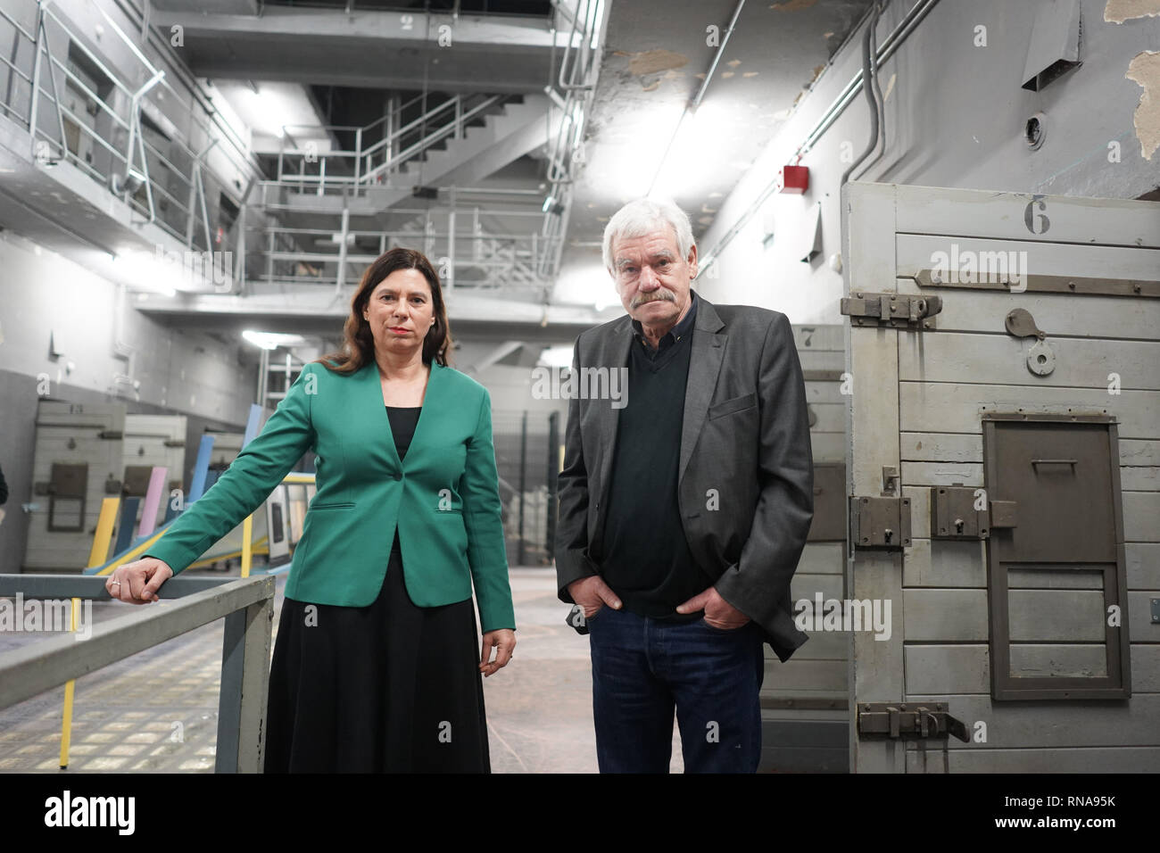 Berlin, Germany. 18th Feb, 2019. Sandra Scheeres (SPD), Berlin's senator for education, and the 70-year-old contemporary witness Michael Brack, open an extracurricular place of learning in the former GDR police prison Keibelstraße in Berlin. According to the Senator, young people there will be able to deal with state arbitrariness and repression in the GDR in the future. Guided tours of the building are also planned for interested visitors. The prison stood empty for years, the use had been struggled for a long time. Credit: Jörg Carstensen/dpa/Alamy Live News - Stock Image