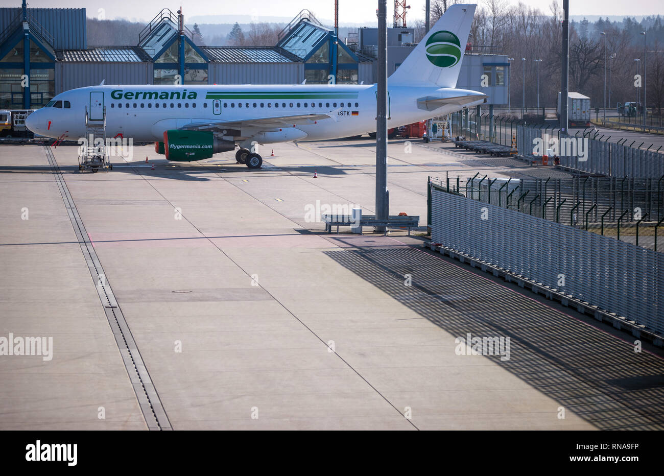 Laage, Germany. 18th Feb, 2019. A parked plane of the insolvent airline Germania stands on a parking position of the airport Rostock-Laage. Following the insolvency of the British regional airline Flybmi and the holiday airline Germania, the airport's shareholders are discussing the economic situation. For the airport Rostock-Laage the Flybmi flights to Munich were the last regular connections. Credit: Jens Büttner/dpa-Zentralbild/dpa/Alamy Live News - Stock Image