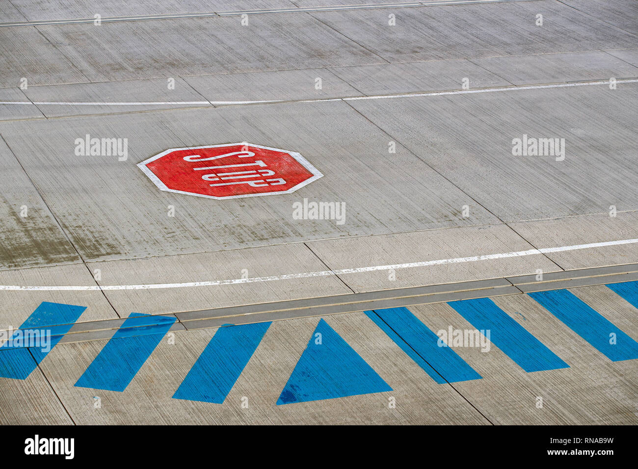 Laage, Germany. 18th Feb, 2019. A stop sign on the apron of the airport Rostock-Laage. Following the insolvency of the British regional airline Flybmi and the holiday airline Germania, the airport's shareholders are discussing the economic situation. For the airport Rostock-Laage the Flybmi flights to Munich were the last regular connections. Credit: Jens Büttner/dpa-Zentralbild/ZB/dpa/Alamy Live News - Stock Image