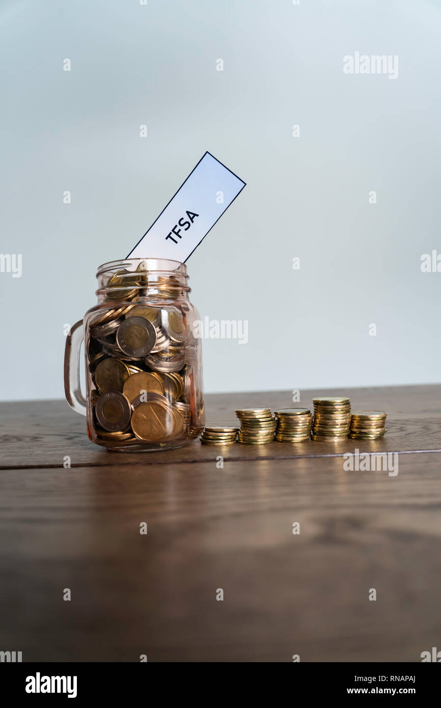 Jar of Coins showing savings to a Tax Free Savings Account - Stock Image