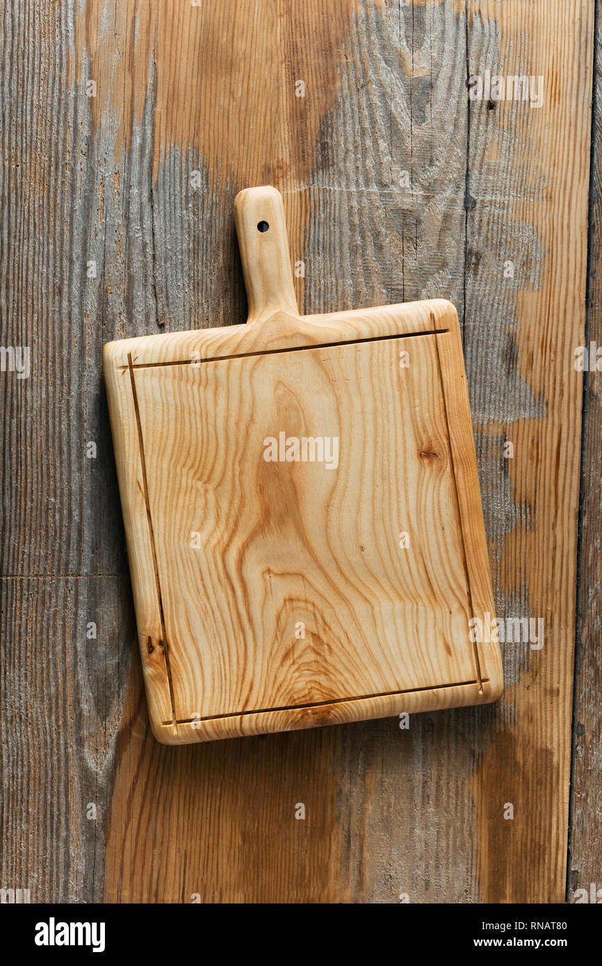 Cutting board handmade on wooden kitchen table top view ...