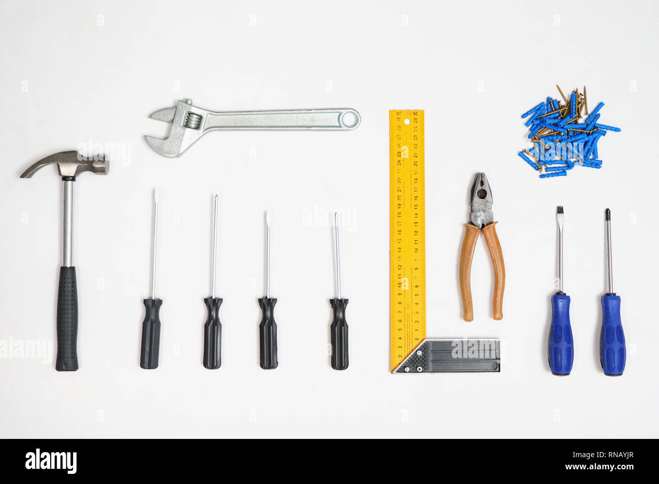 Tools and nails in composition on white background - Stock Image