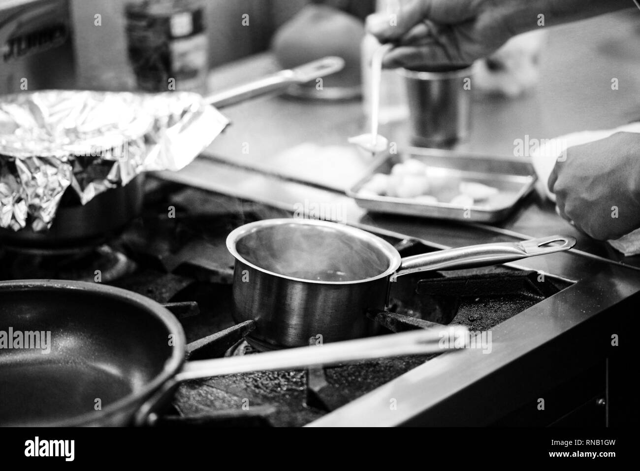 Chef Preparing Food Meal In The Kitchen Cooking Decorating Dish Closeup Stock Photo Alamy