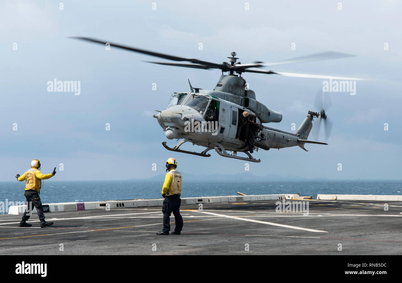 190216-N-DX072-1224 GULF OF THAILAND (Feb. 16, 2019) – A UH-1Y Huey helicopter, assigned to the Marine Light Attack Helicopter Squadron (HMLA) 267, lands on the flight deck of the amphibious transport dock ship USS Green Bay (LPD 20) during a casualty evacuation exercise. Green Bay, part of the Wasp Amphibious Ready Group, with embarked 31st Marine Expeditionary Unit (MEU), is in Thailand to participate in Exercise Cobra Gold 2019. Cobra Gold is a multinational exercise co-sponsored by Thailand and the United States that is designed to advance regional security and effective response to crisis - Stock Image